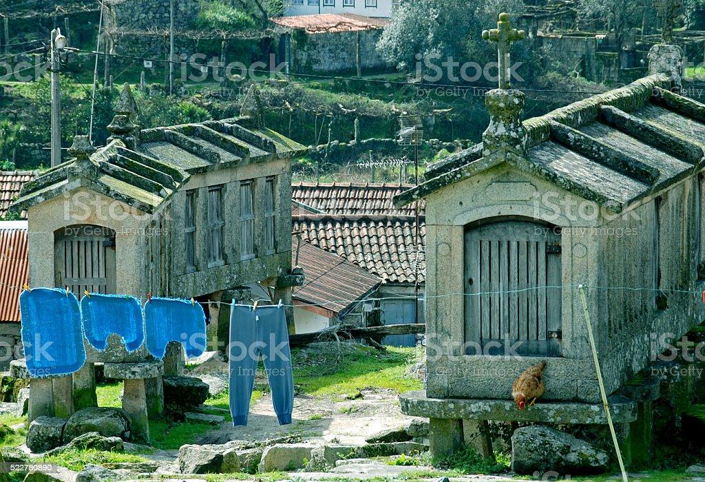 Galician granaries collected near castle in Lindoso Portugal stock photo