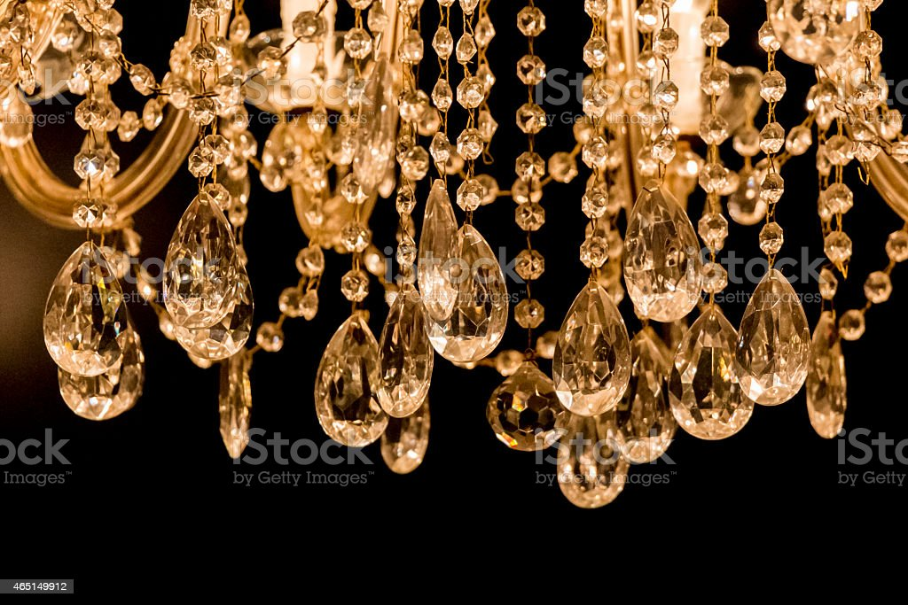 Gallant chandelier with light candles and dark background stock photo