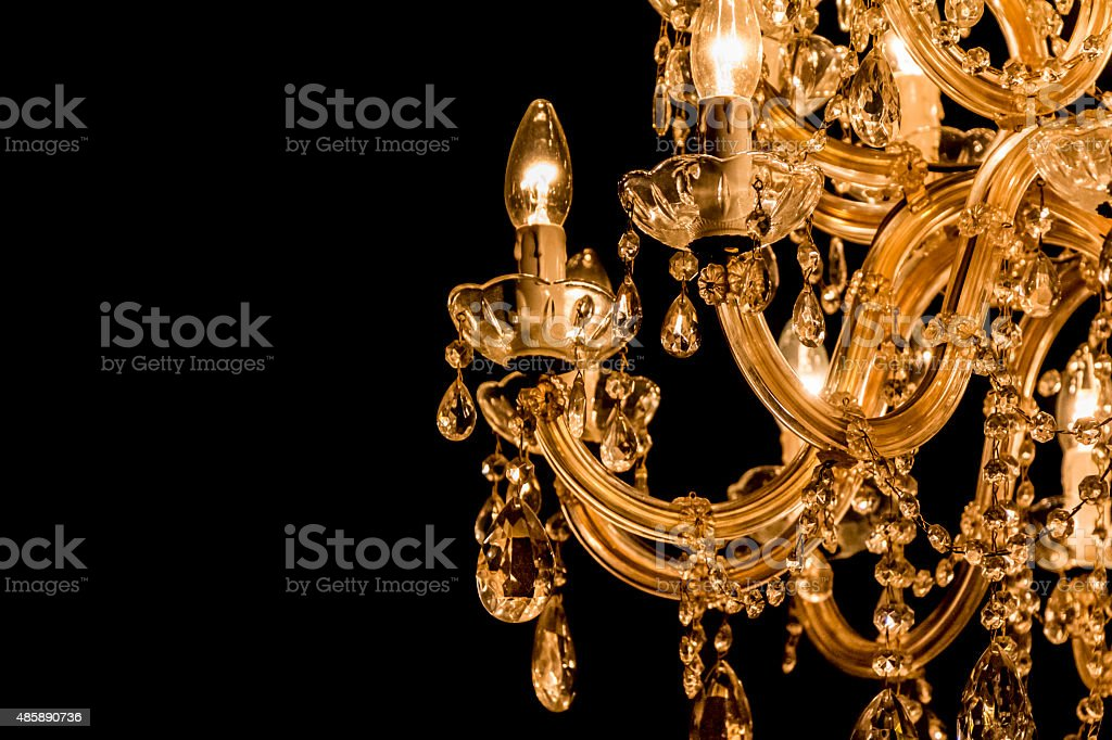 Gallant chandelier with light candles and dark side background stock photo