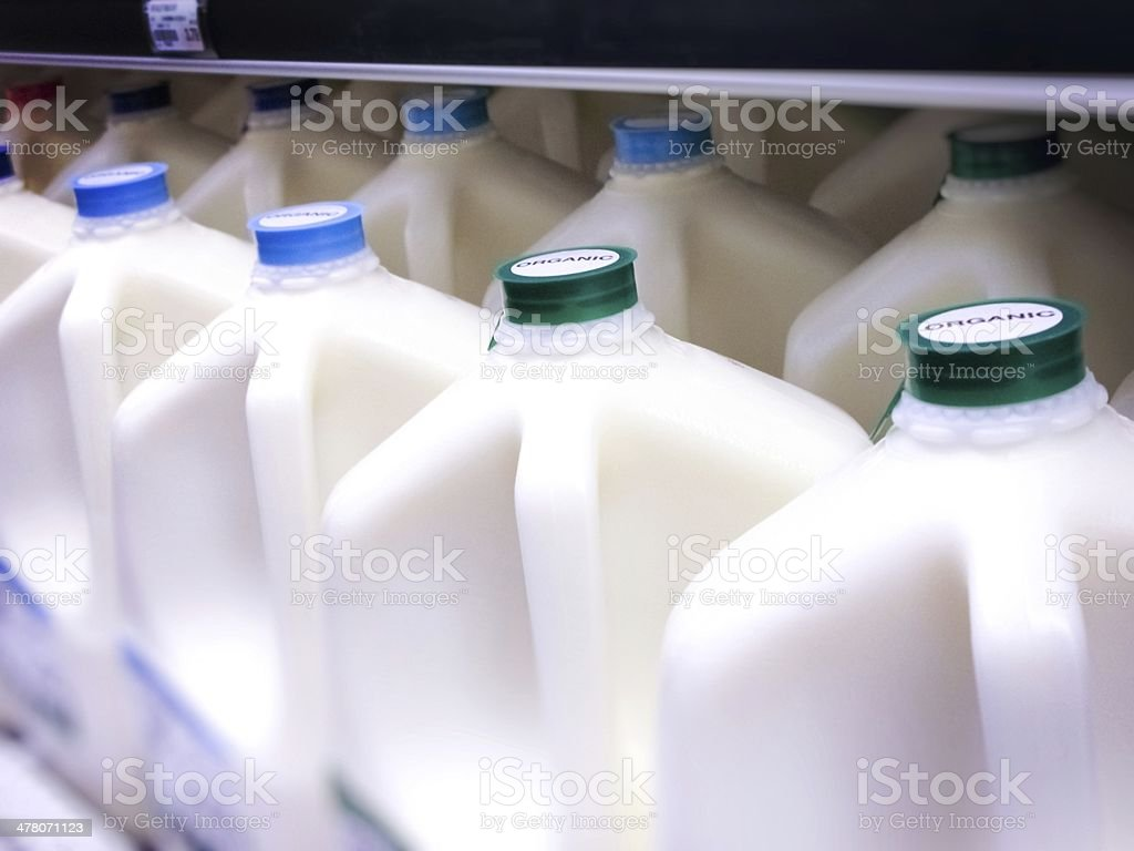 Gallon Jugs of Organic Milk at the Supermarket stock photo