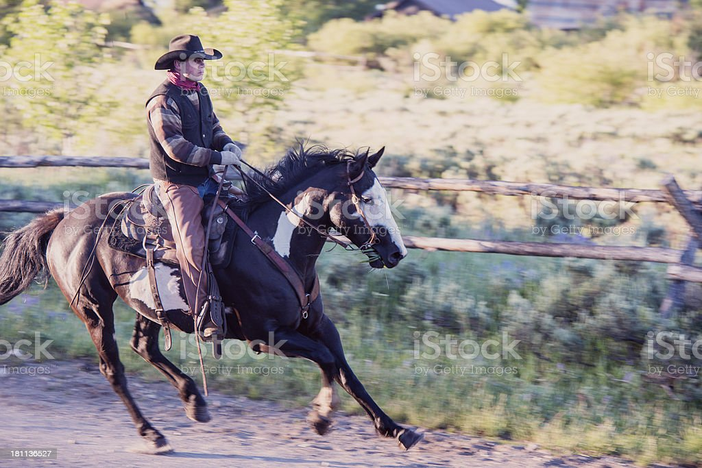 Galloping Cowboy in West Yellowstone Montana royalty-free stock photo