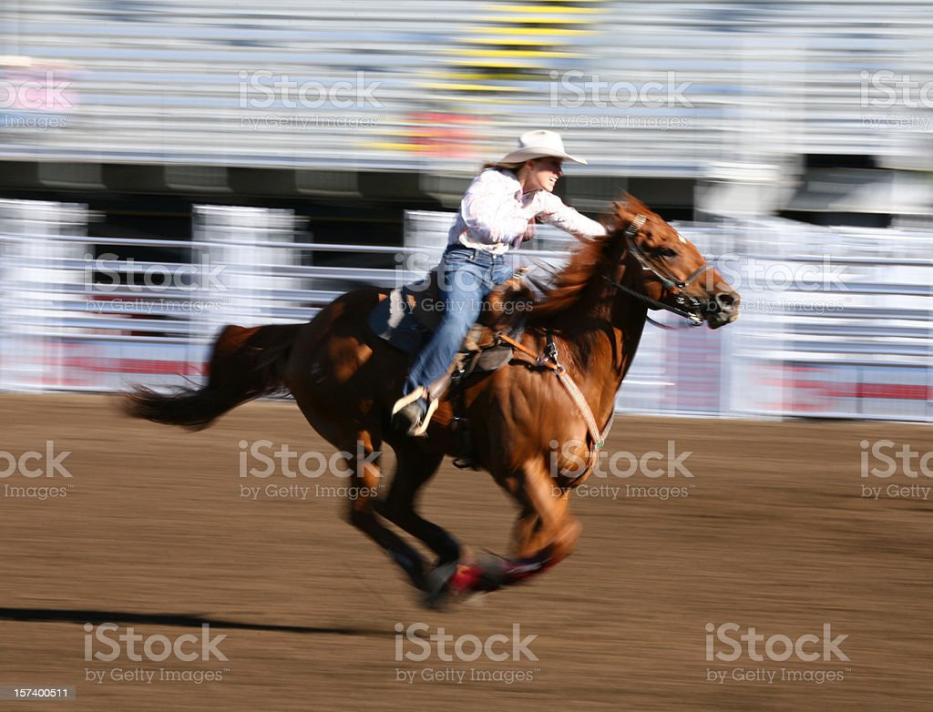 Galloping horse with rider at a rodeo stock photo