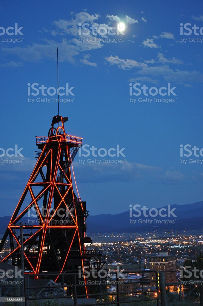 Gallow Frame in Red Neon, Full Moon in Butte, Montana stock photo