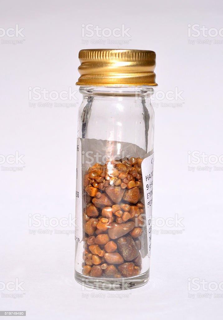 Gallstones in specimen jar. stock photo