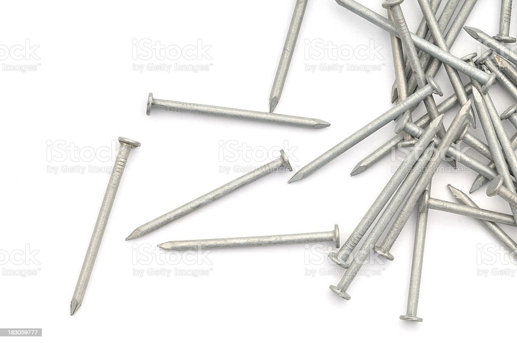 Galvanised nails scattered stock photo
