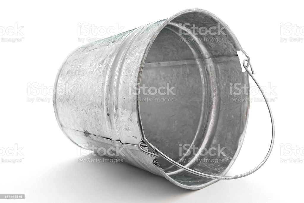galvanized metal pail tipped on side stock photo