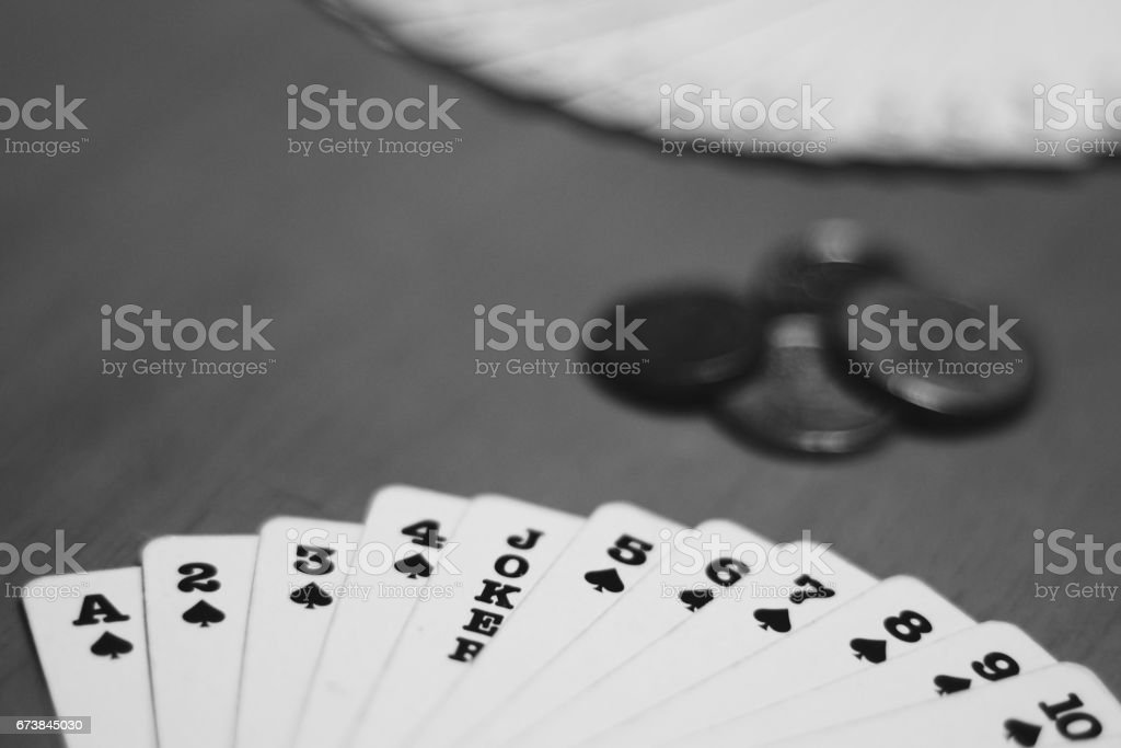 Gamble on playing cards stock photo