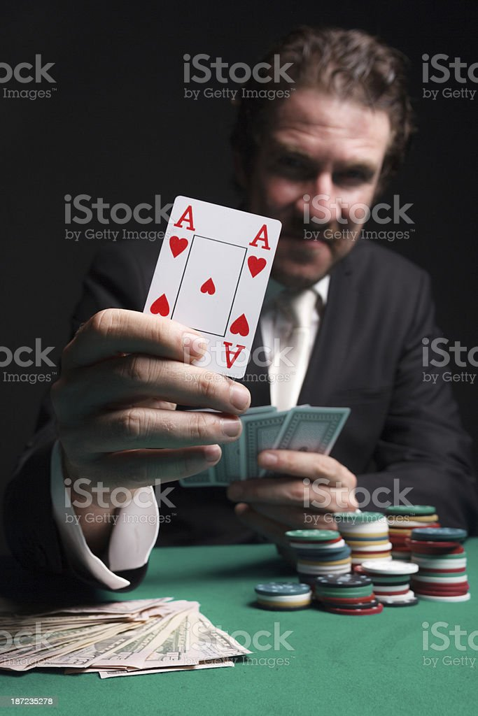 Gambler holding ace of hearts card stock photo
