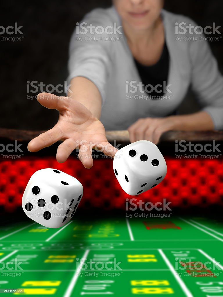 gambler playing dices at casino stock photo