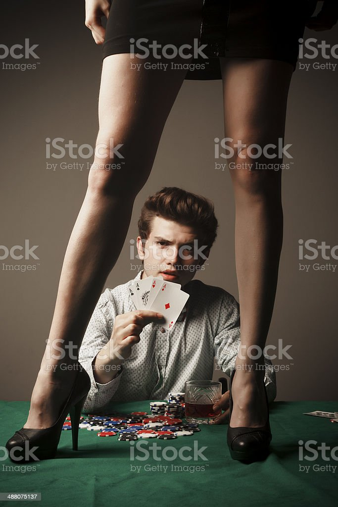 Gambler showing four aces stock photo
