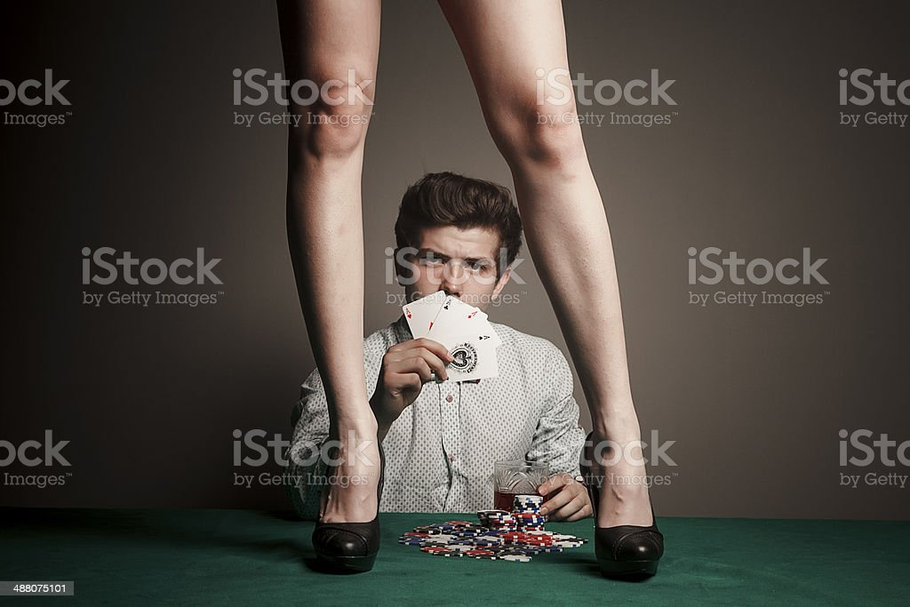 Gambler with sexy woman legs stock photo