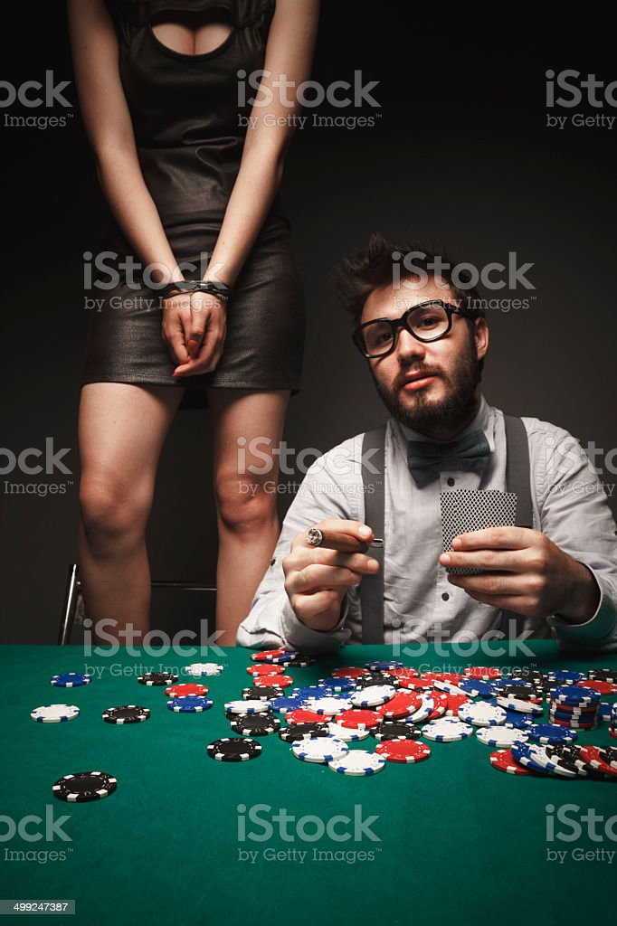 Gambler with standing sexy woman stock photo