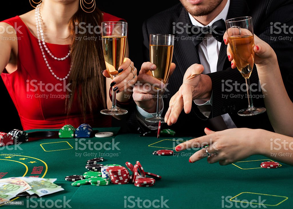Gamblers drinking champagne stock photo