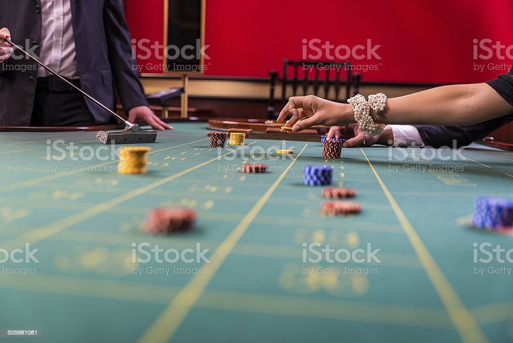 Gamblers playing roulette in a casinoi stock photo