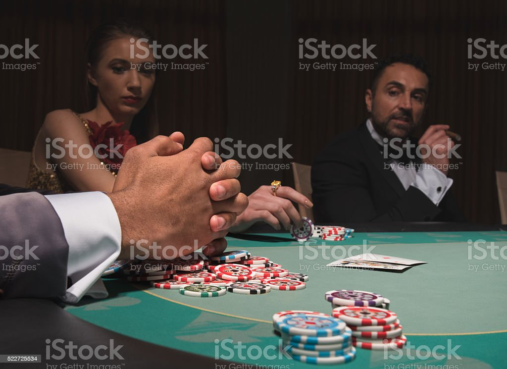 Gamblers sitting at the poker table stock photo
