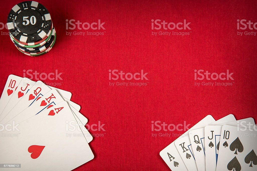 Gambling chips and card for poker on red felt background stock photo