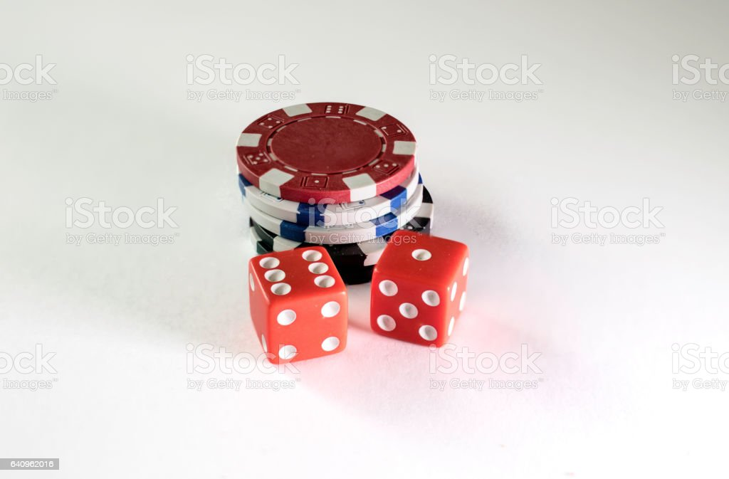 Gambling chips and dice on a white background stock photo