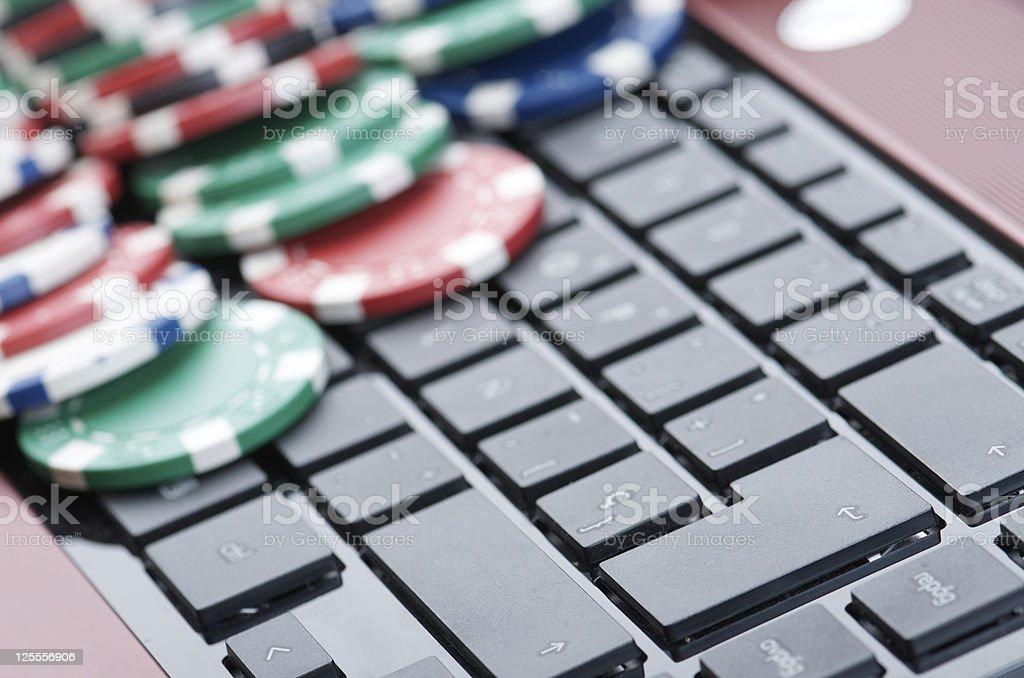 Gambling chips on computer keyboard stock photo