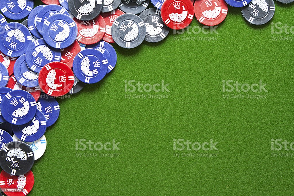 Gambling chips on green felt royalty-free stock photo
