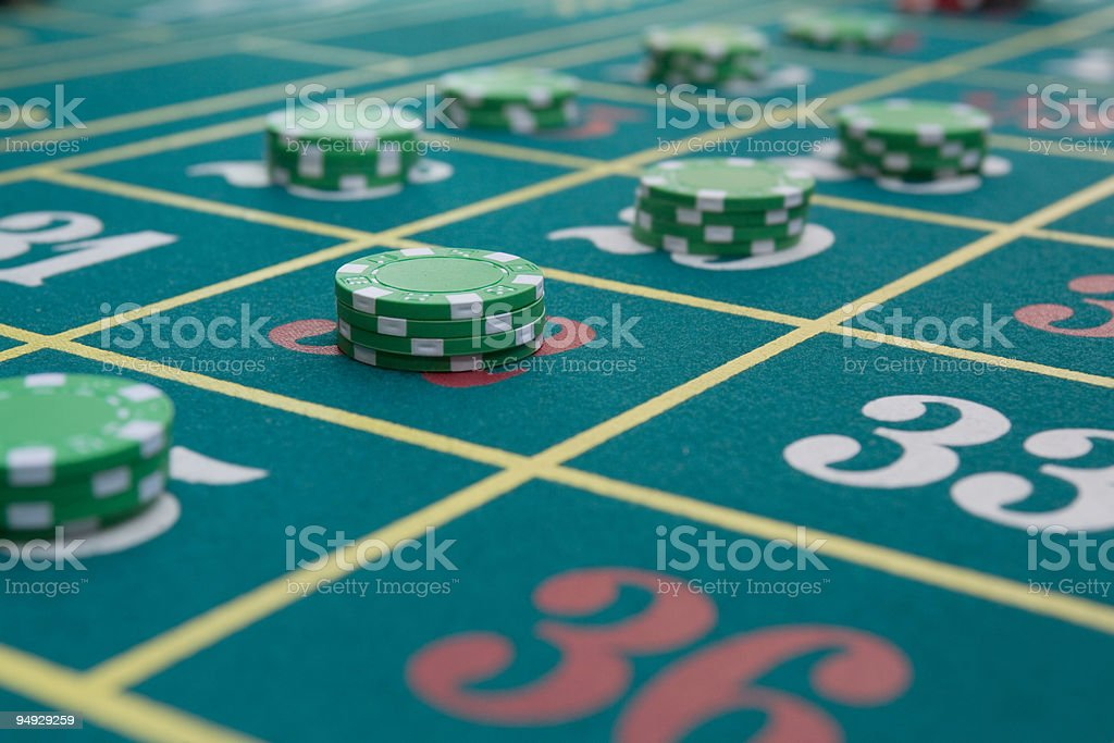 Gambling chips on roulette table royalty-free stock photo