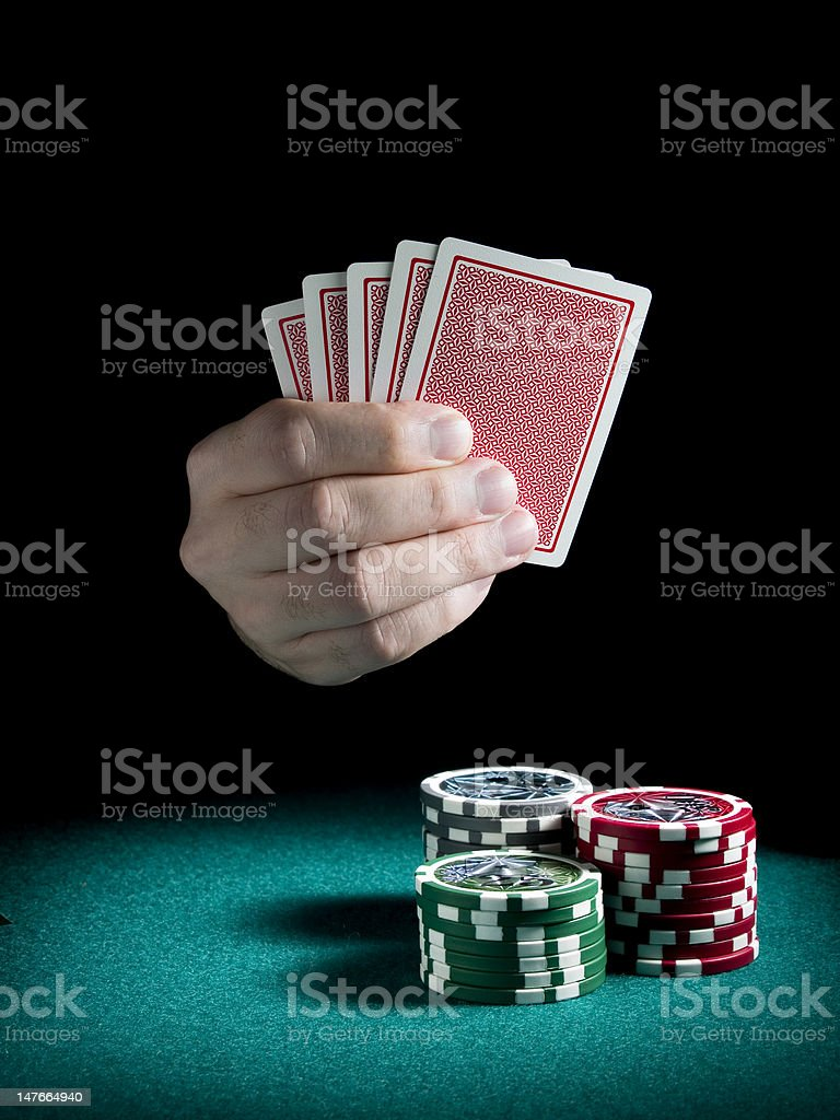 Gambling hand royalty-free stock photo