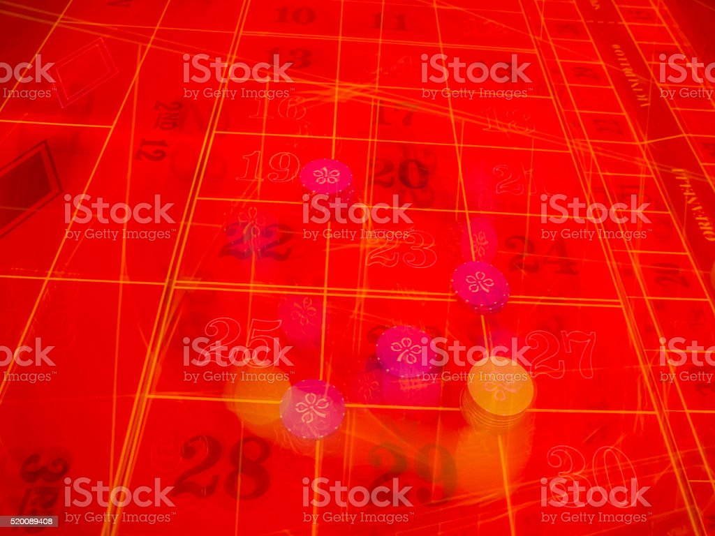 Gambling in action, moving numbers and chips on table stock photo
