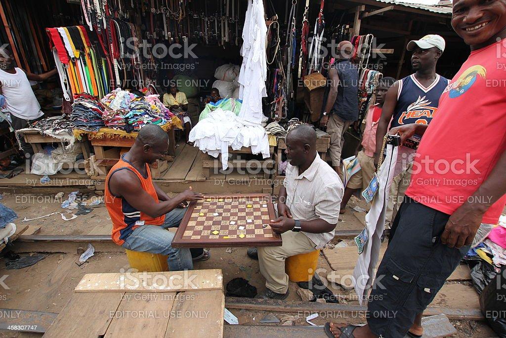 Gambling Men in an African Market stock photo