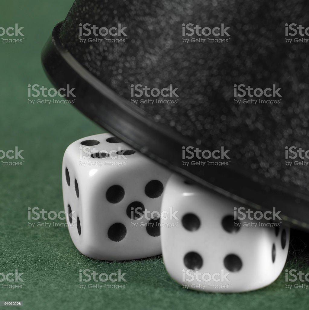 gambling tension with hidden dice stock photo