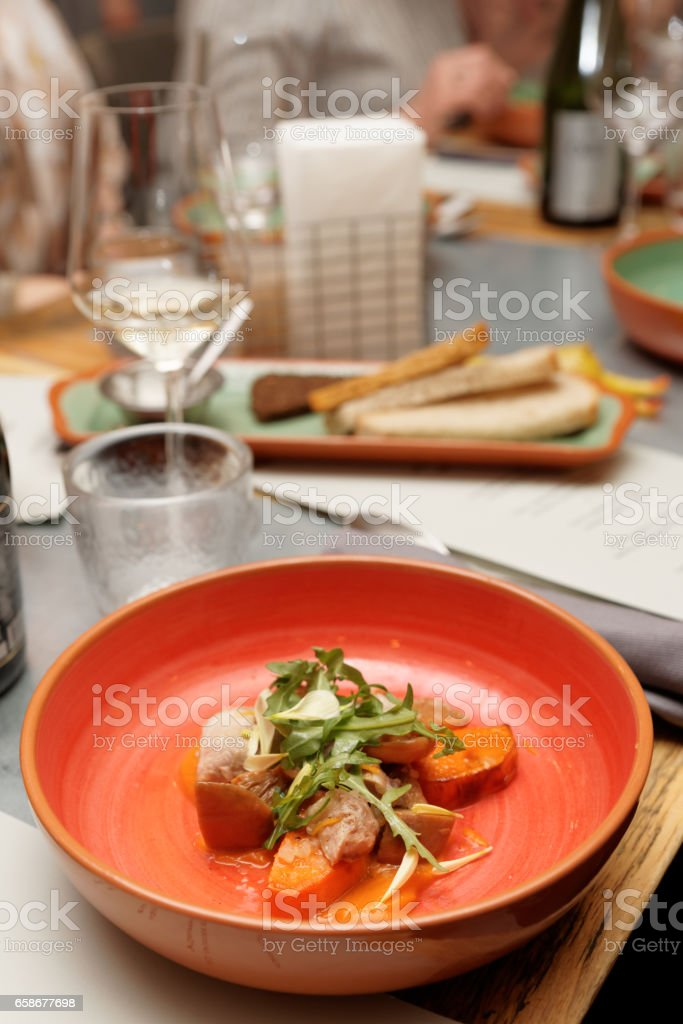 Game bird fillet with sweet potato mash in red clay plate stock photo