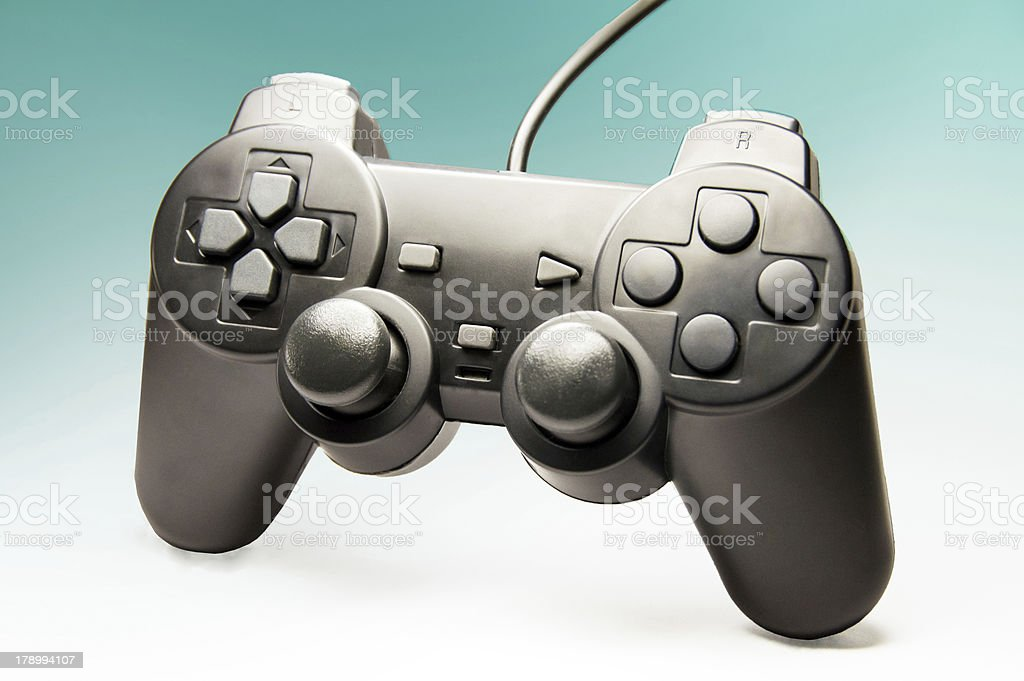 Game controller on blue background royalty-free stock photo