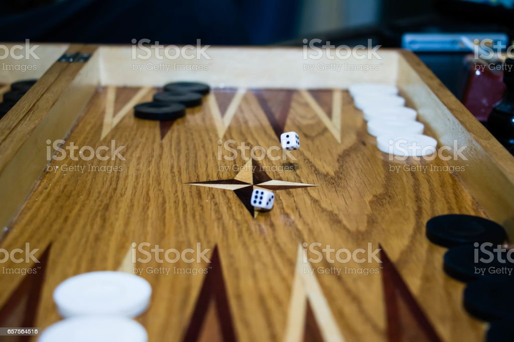 Game field in a backgammon with cubes and counters stock photo