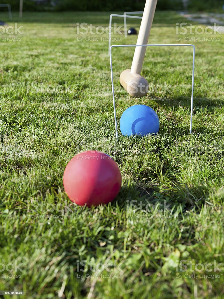 game of croquet on green lawn stock photo