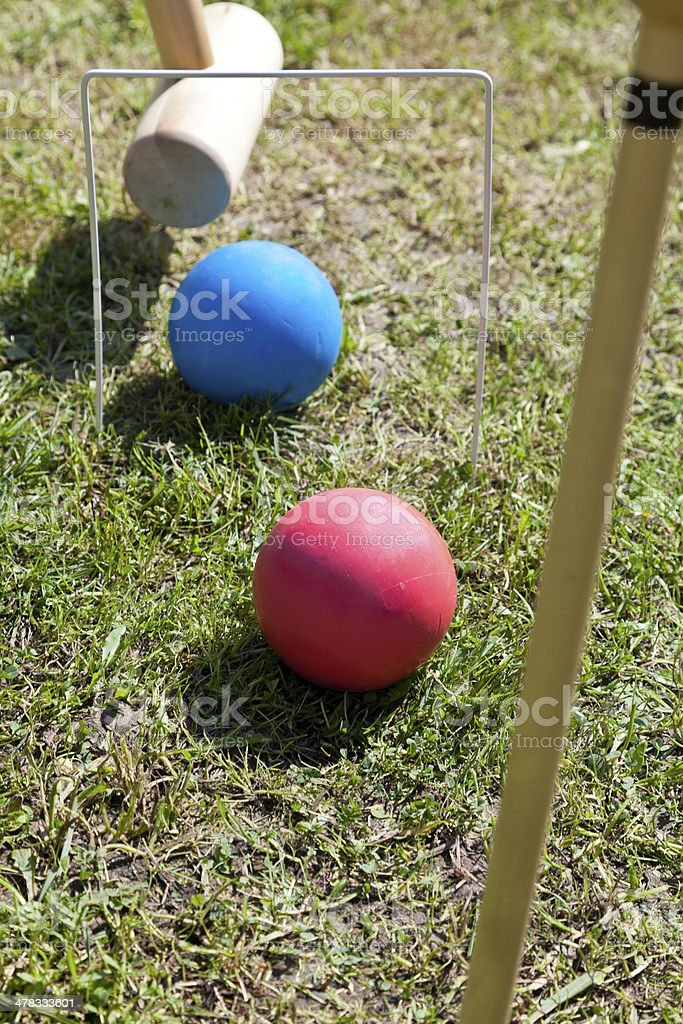 game of croquet on green lawn royalty-free stock photo