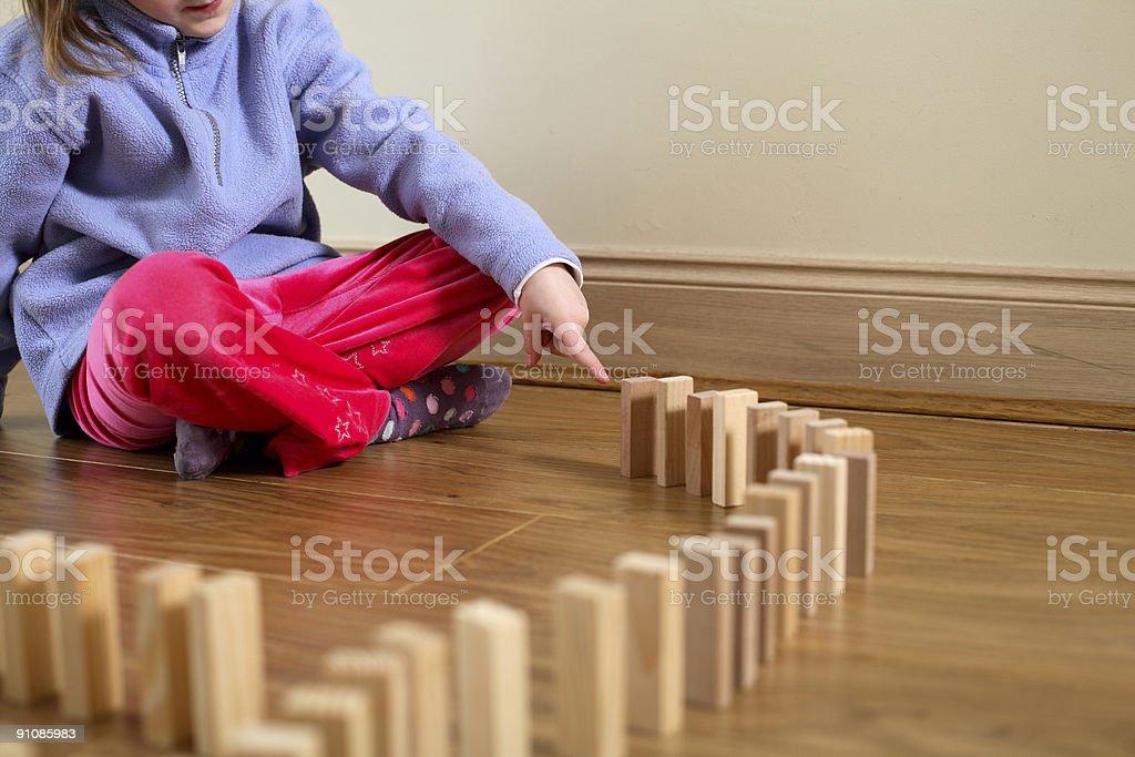 Game of domino tumbling stock photo