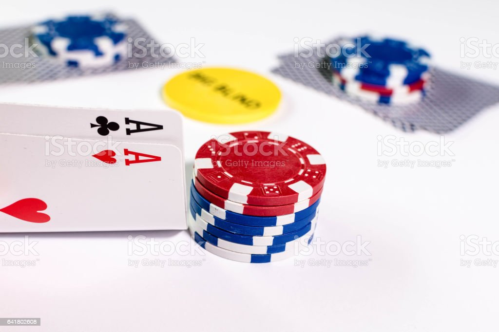 A Game of Texas Holdem Poker with betting chips stock photo