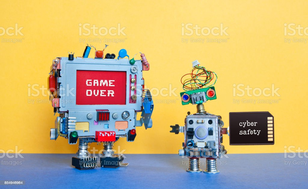 Game over cyber safety concept. Creative design robotic toys on blue...