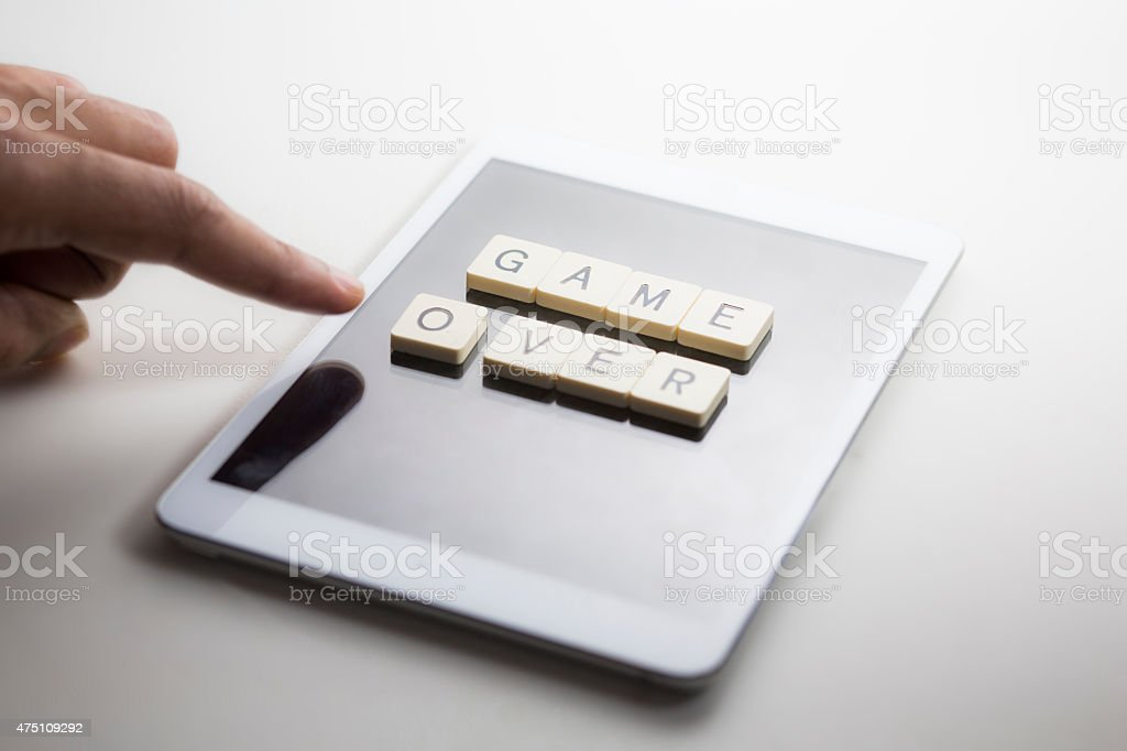 Game over tablet gaming stock photo