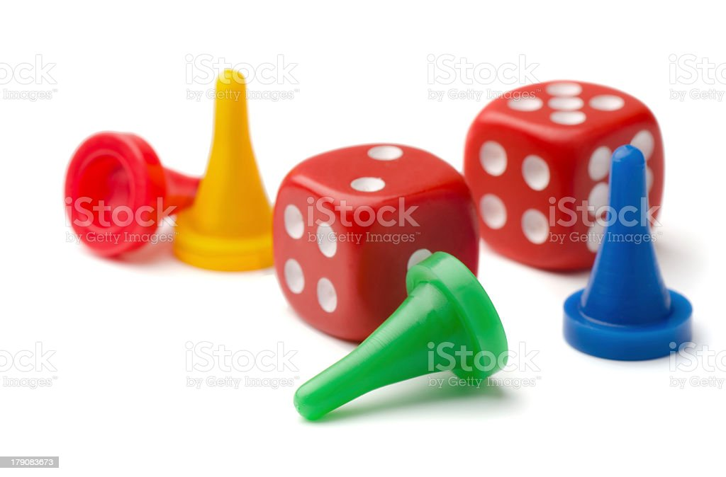 Game pieces and two dice on white background royalty-free stock photo