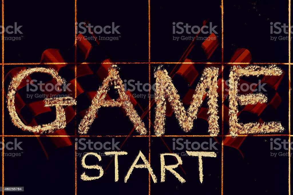 Game start phrase handwritten on black chalkboard stock photo