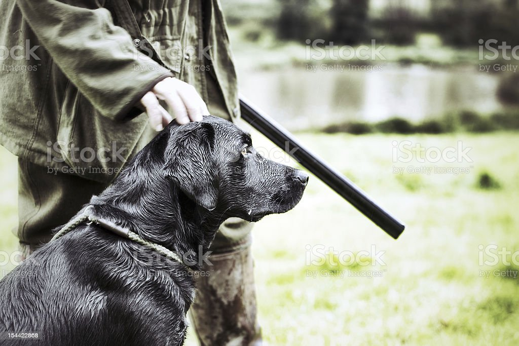 Gamekeeper  with his dog stock photo