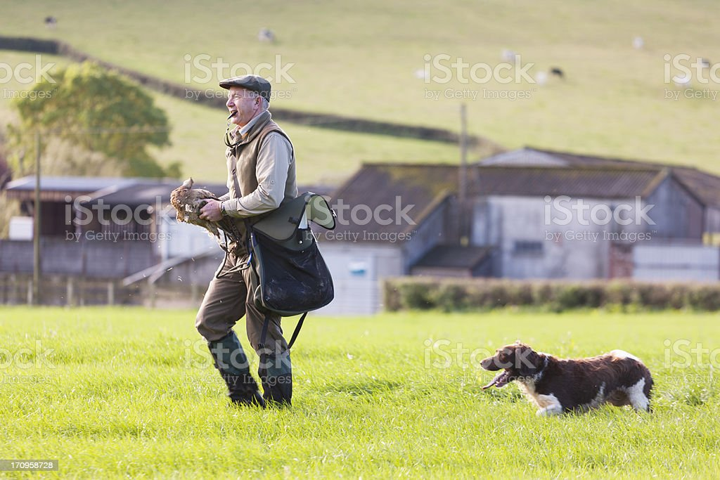 Gamekeeper working with his dog royalty-free stock photo