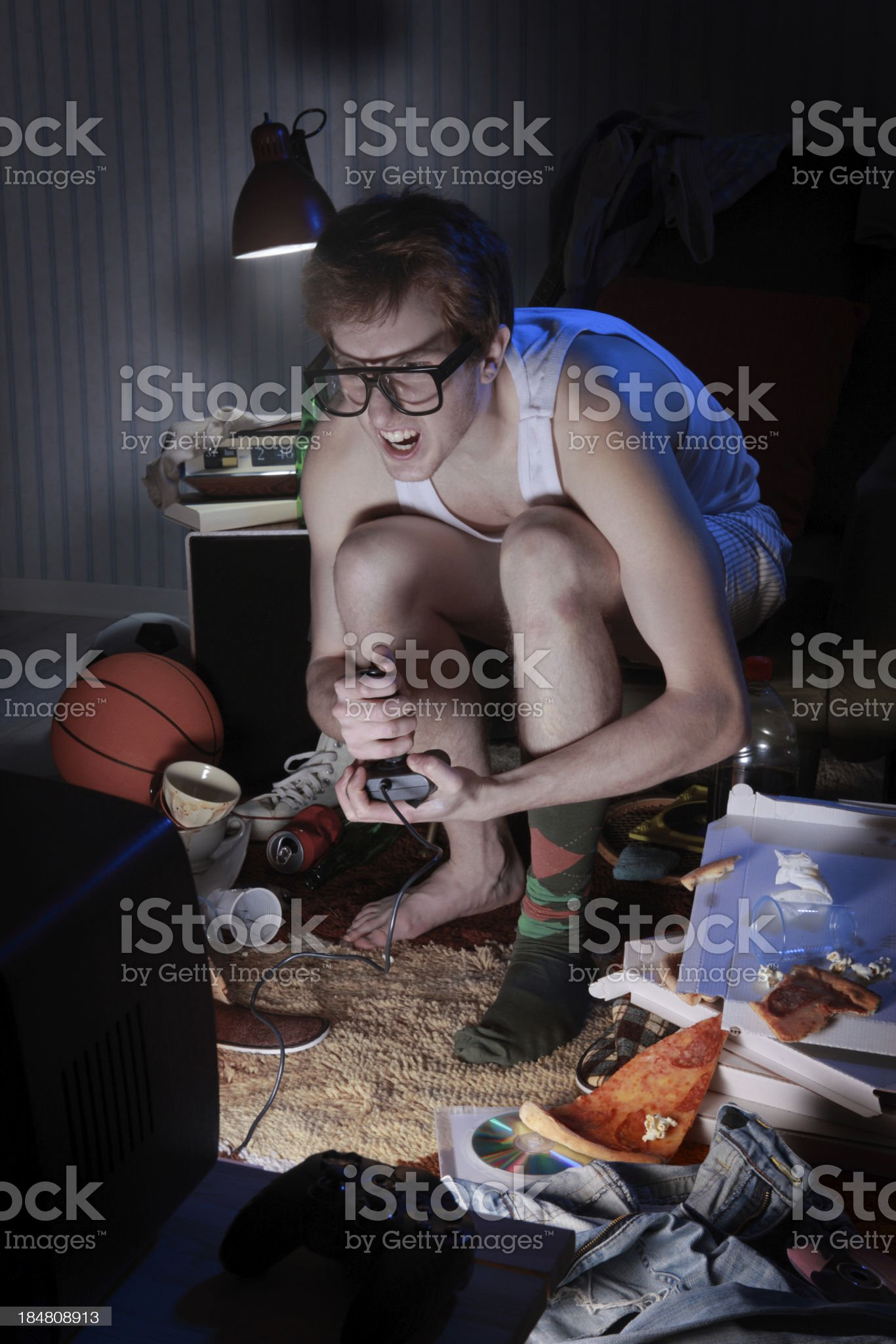Gamer nerd playing video games on television royalty-free stock photo