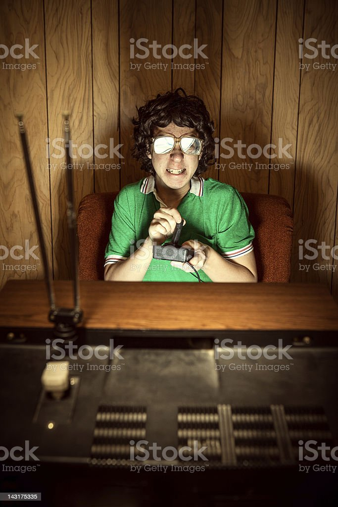 Gamer Nerd Playing Video Games on T.V. royalty-free stock photo