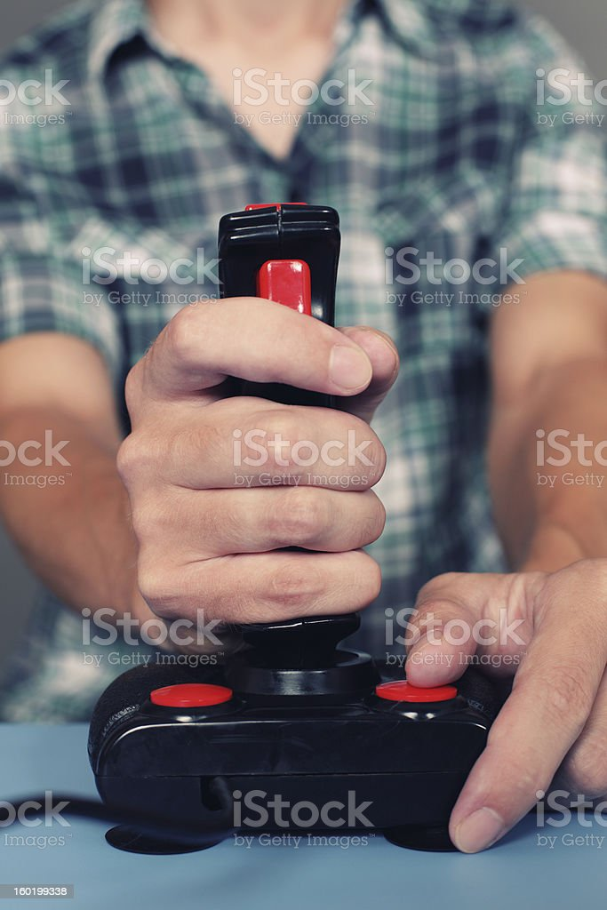 Gamer playing video game with retro joystick royalty-free stock photo