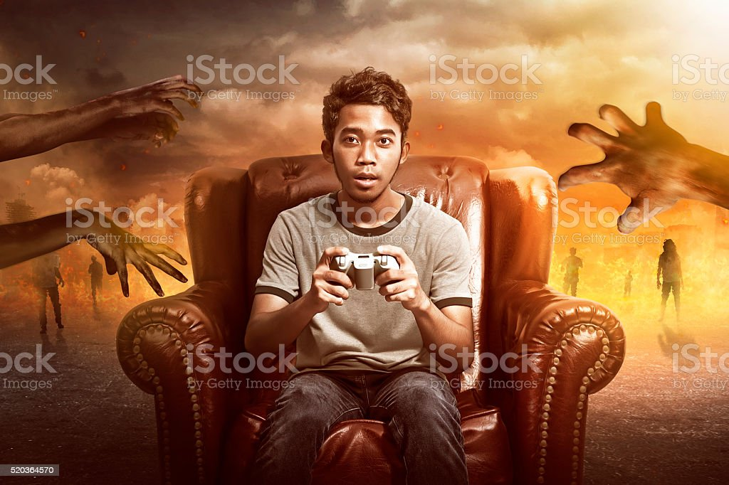 Gamer Playing Zombie Games stock photo