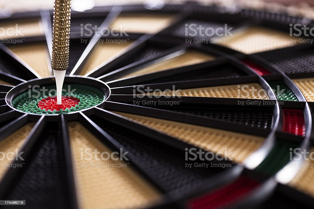 Games: Bullseye. Dart in center. Dartboard.  Indoor recreation. stock photo