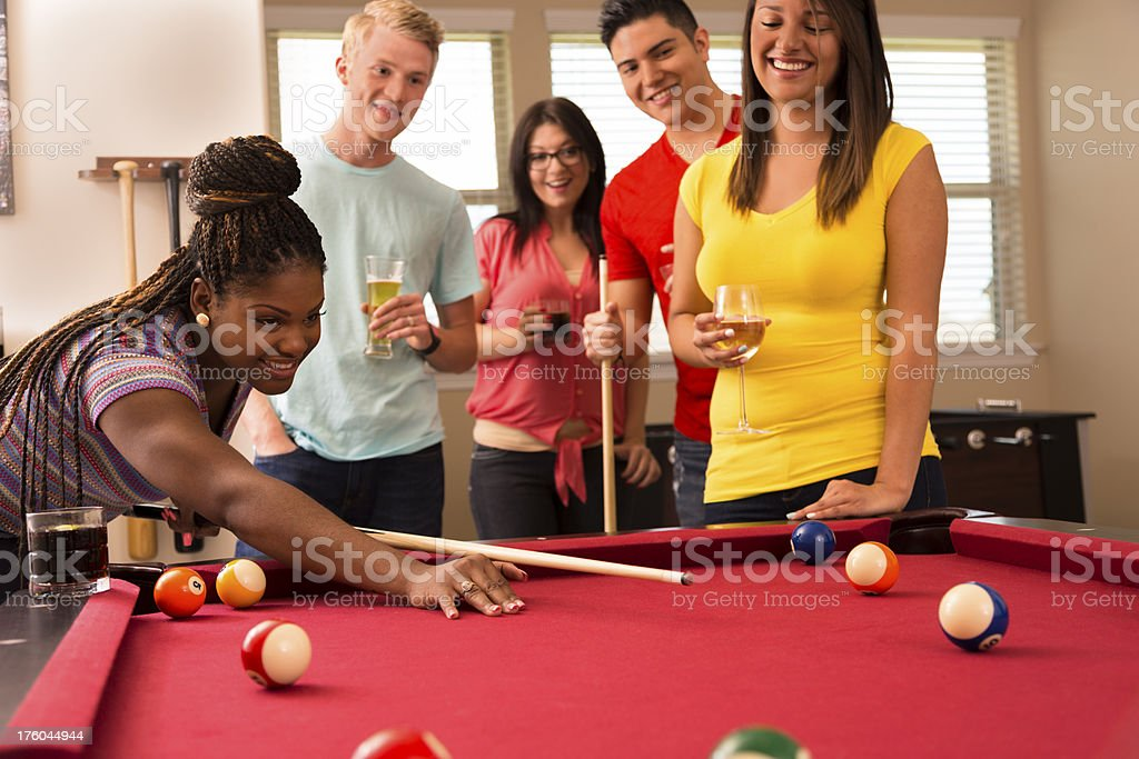 Games: Friends playing pool and having round of drinks. royalty-free stock photo