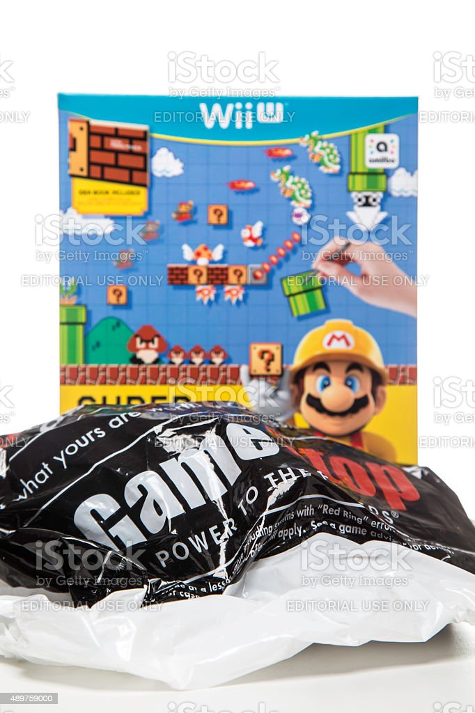 GameStop bag and Wii U video game packaging stock photo
