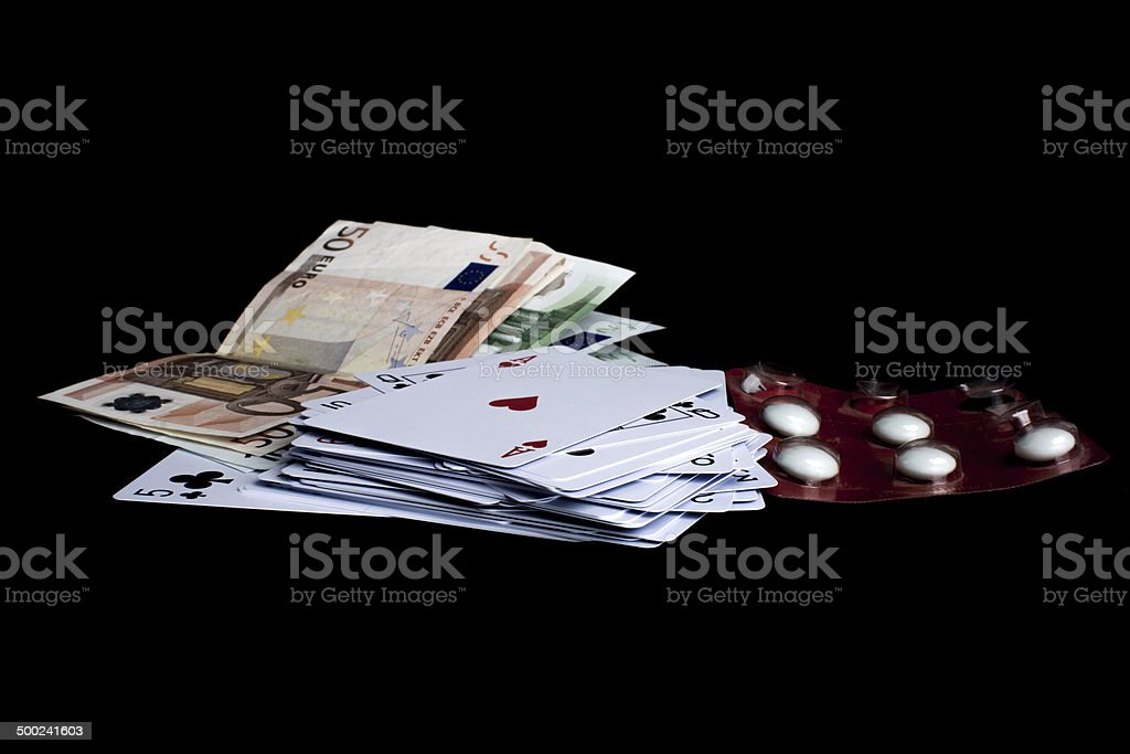 Gaming, money and pills royalty-free stock photo