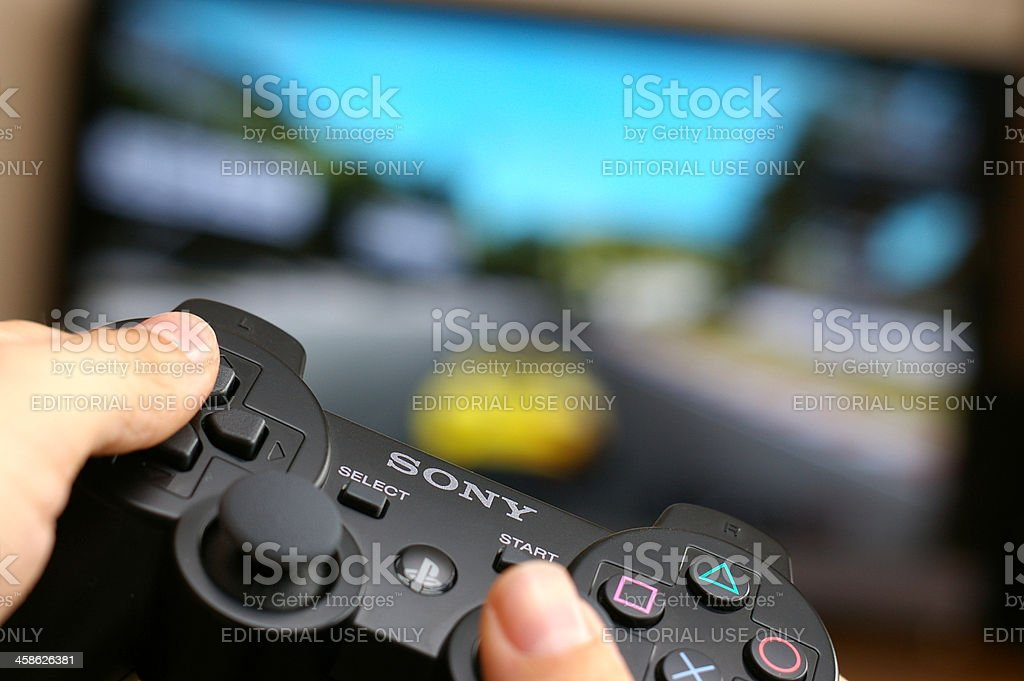Gaming on Playstation 3 stock photo